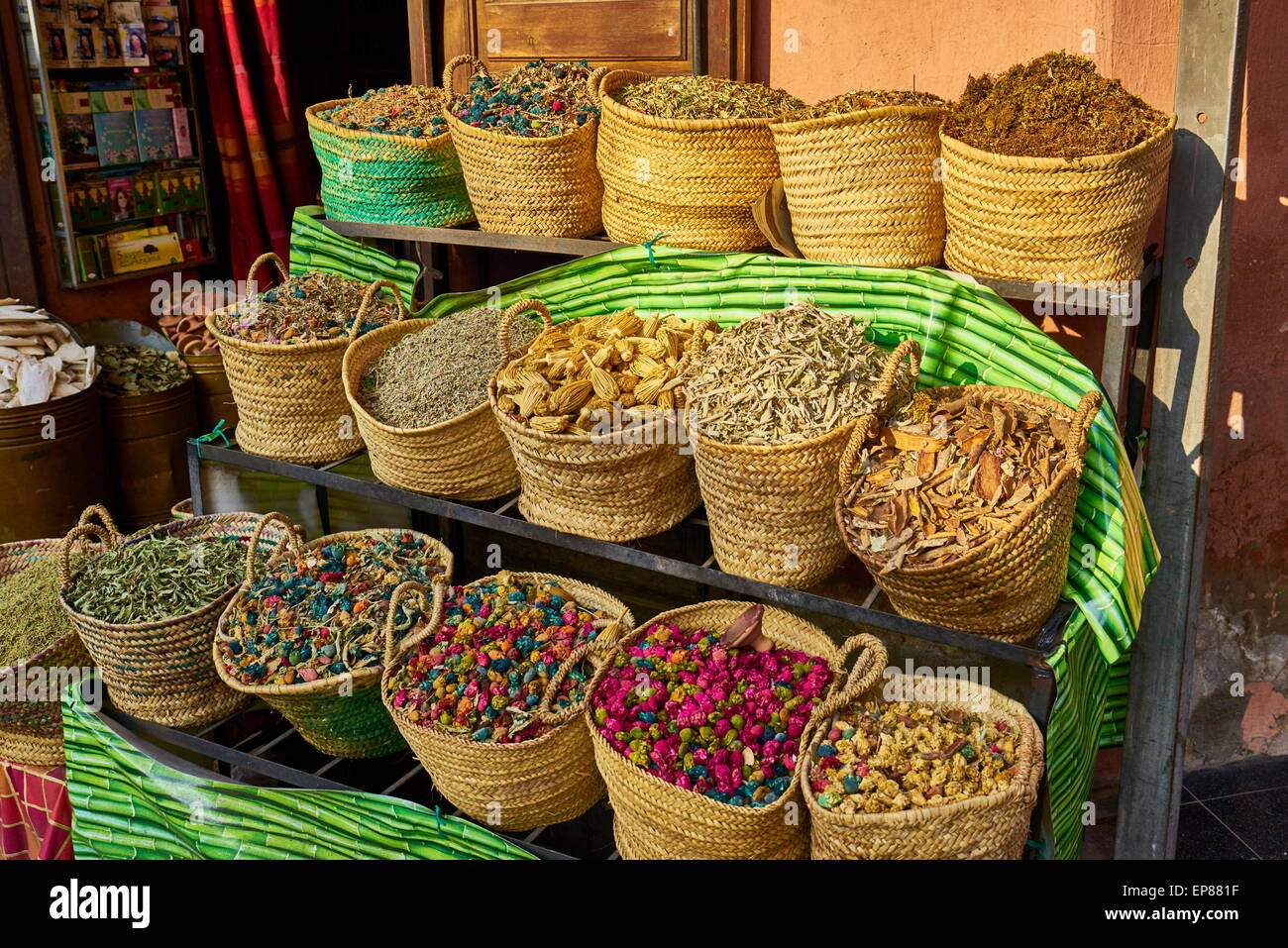 Baskets of dried flowers, rose petals, buds and herbs in the souk. Morocco - Stock Image