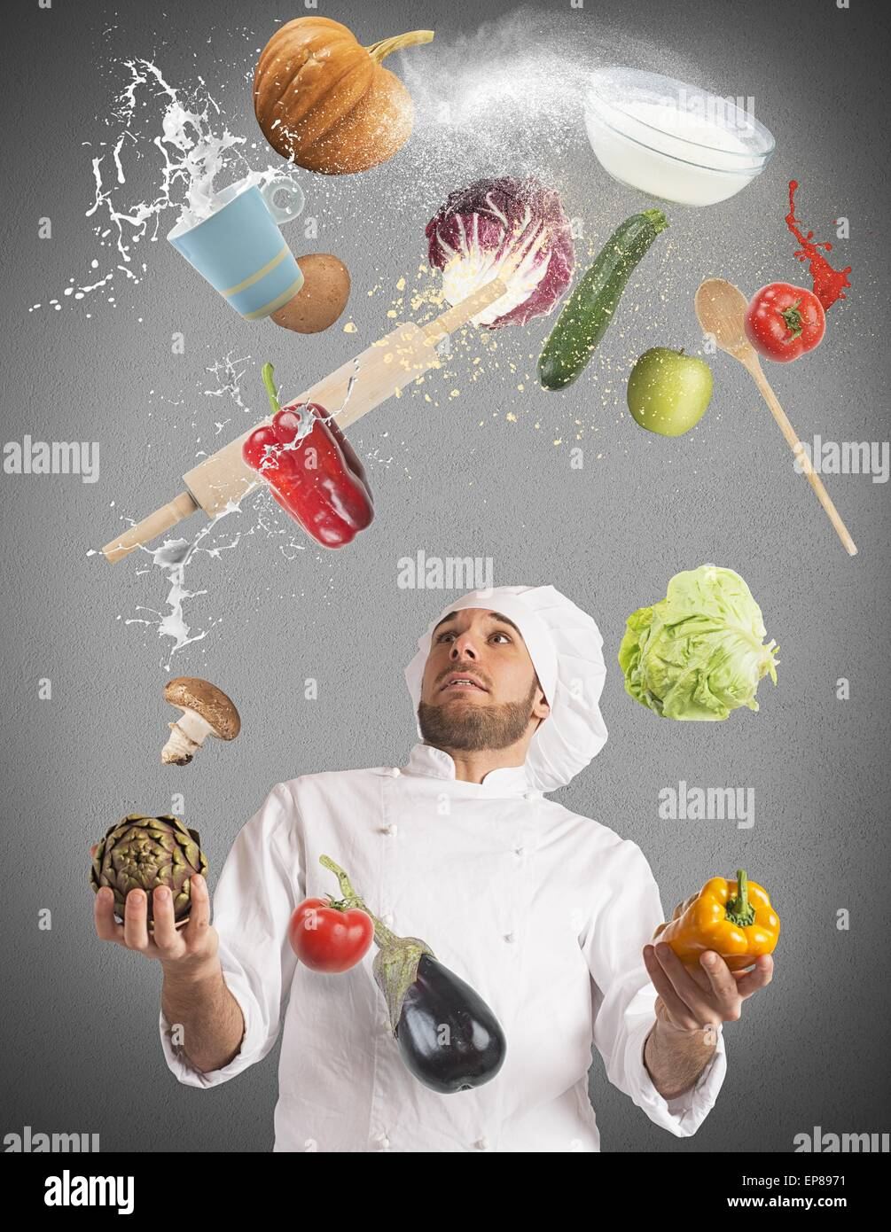 Juggle while cooking - Stock Image