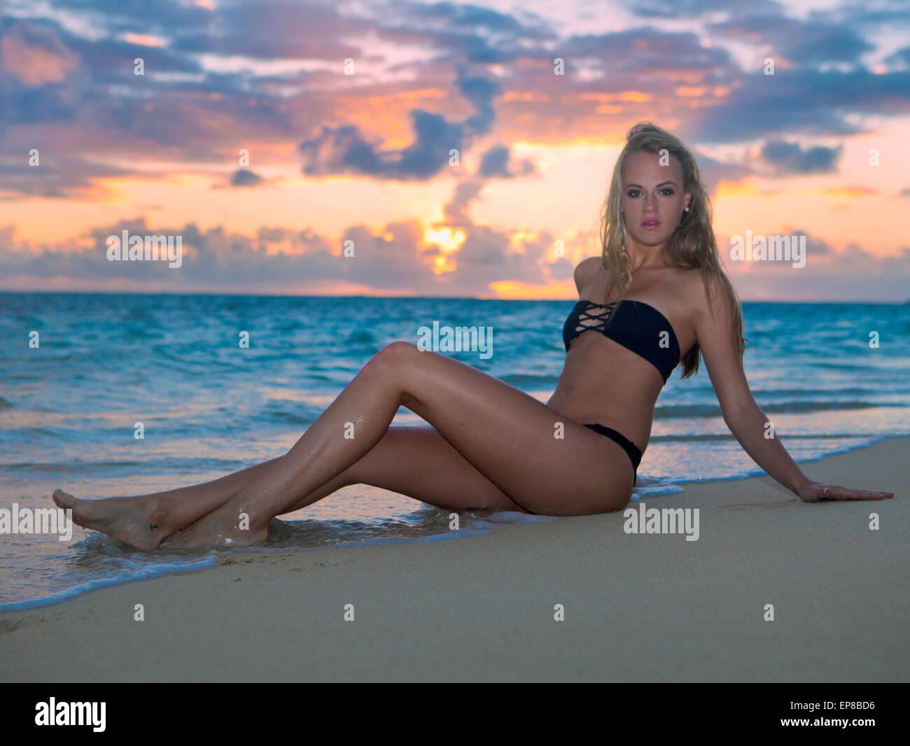 beautiful blond girl in bikini at the beach - Stock Image