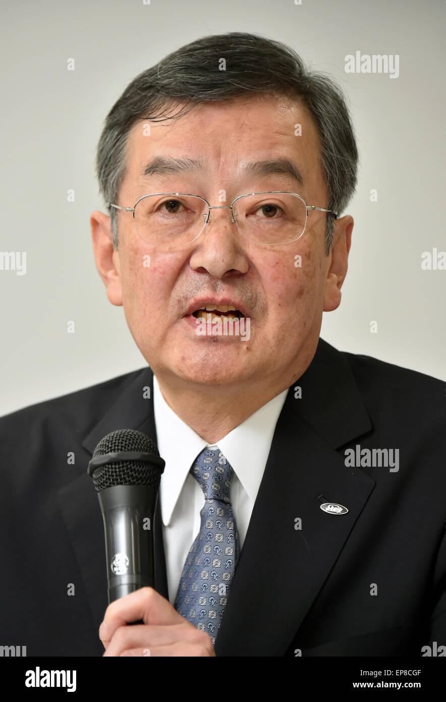 Tokyo, Japan. 14th May, 2015. Kozo Takahasi, president of financially struggling Sharp Corp., announces its medium - Stock Image