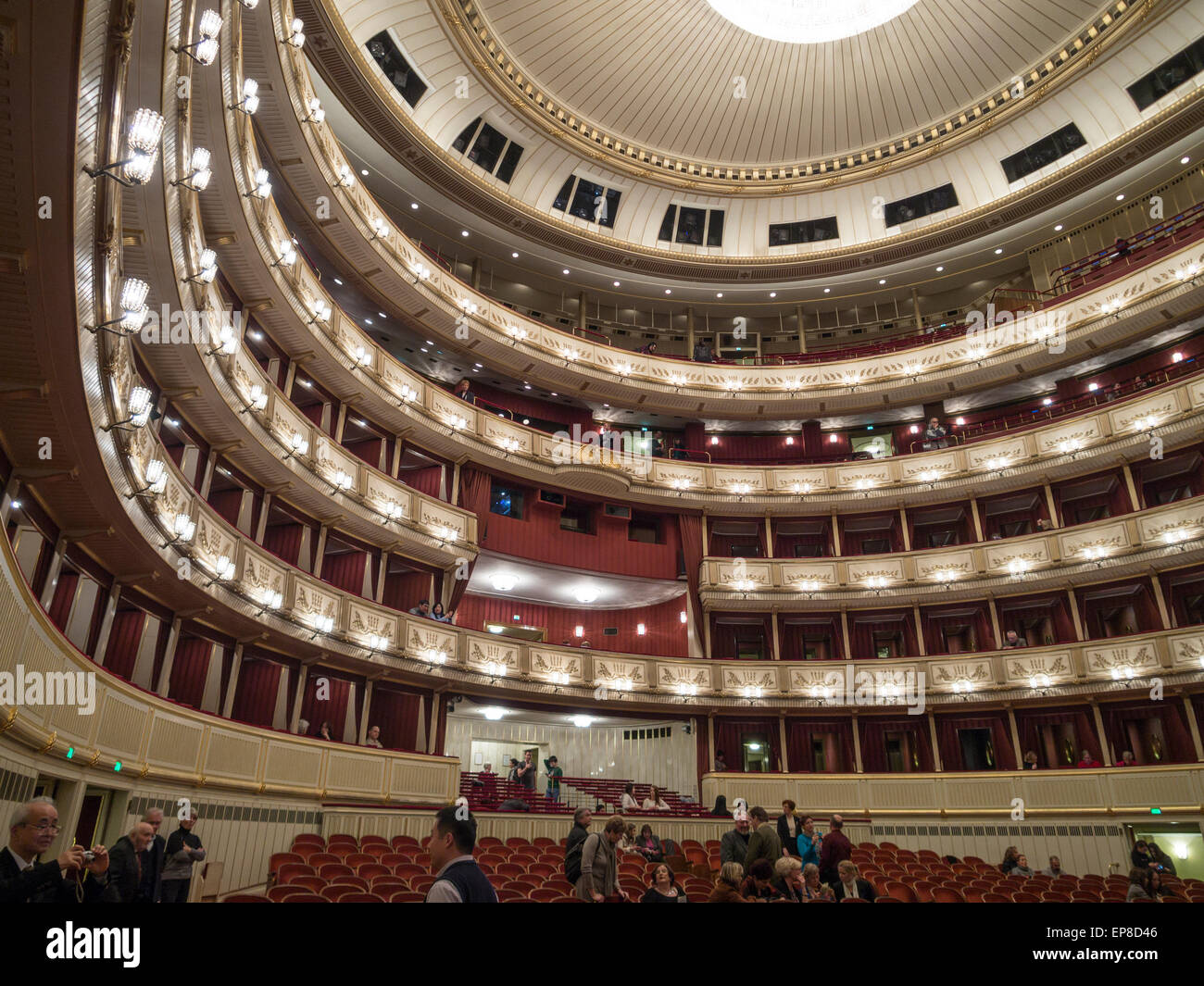 Balconies of the main hall at Vienna State Opera. The curved tiers of balconies with the orchestra seating below. - Stock Image