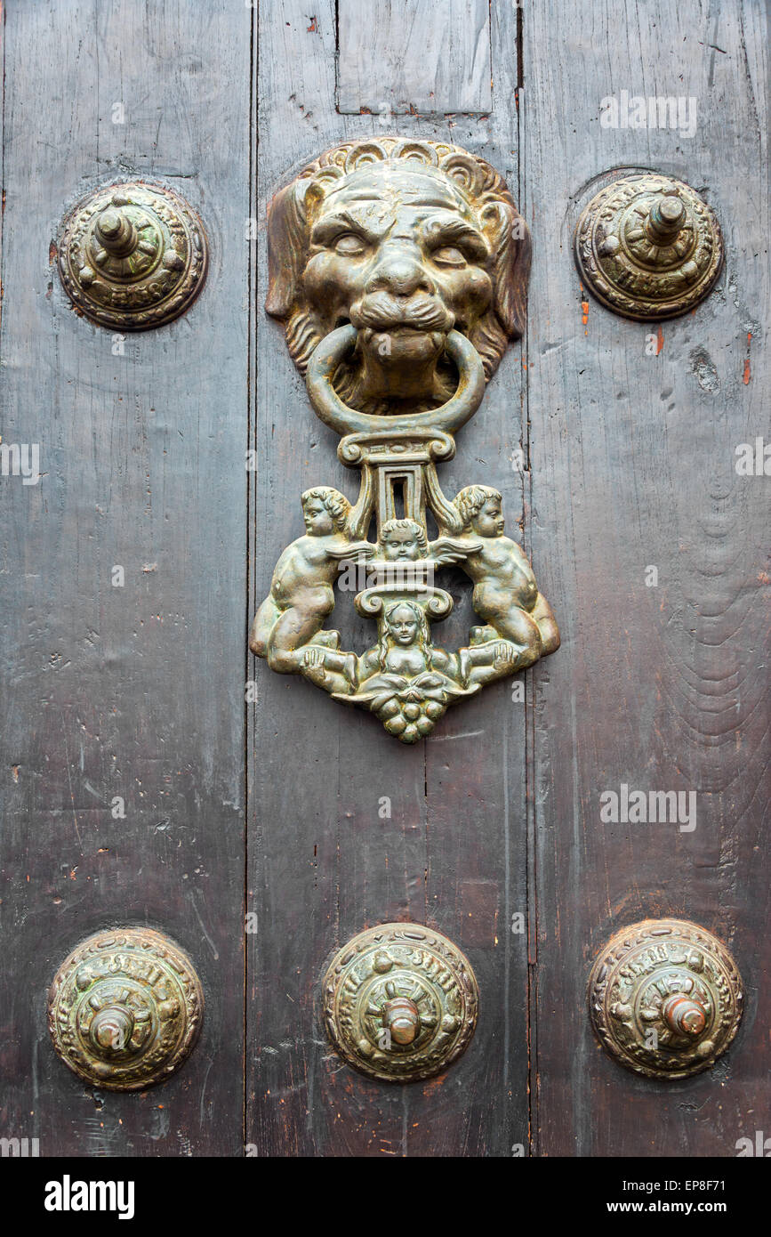 Historic lion shaped door knocker in Lima, Peru - Stock Image