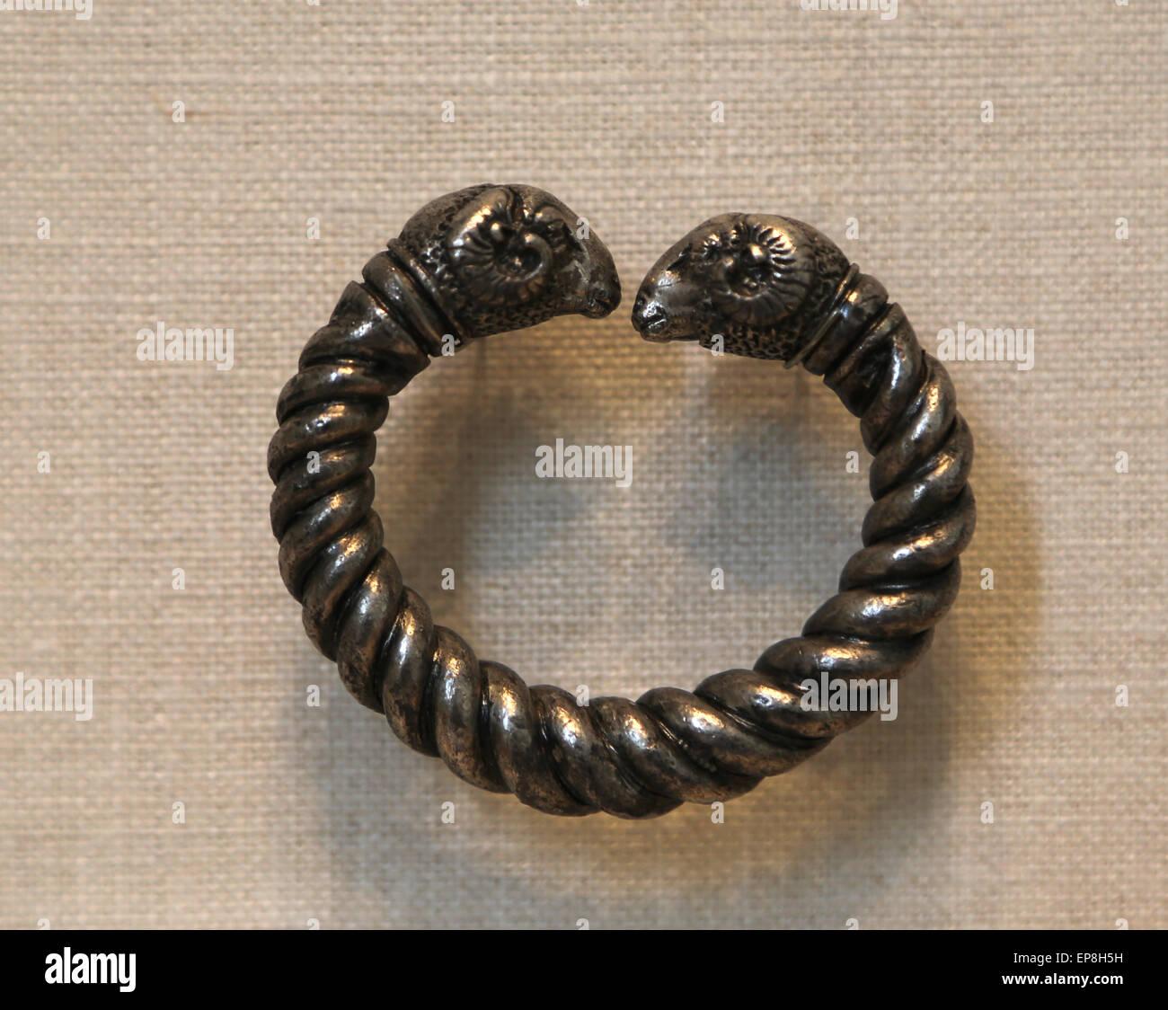 Silver bracelet with ram's head finials. Greek, late 4th century B.C. Metropolitan Museum of Art. Ny. USA. - Stock Image