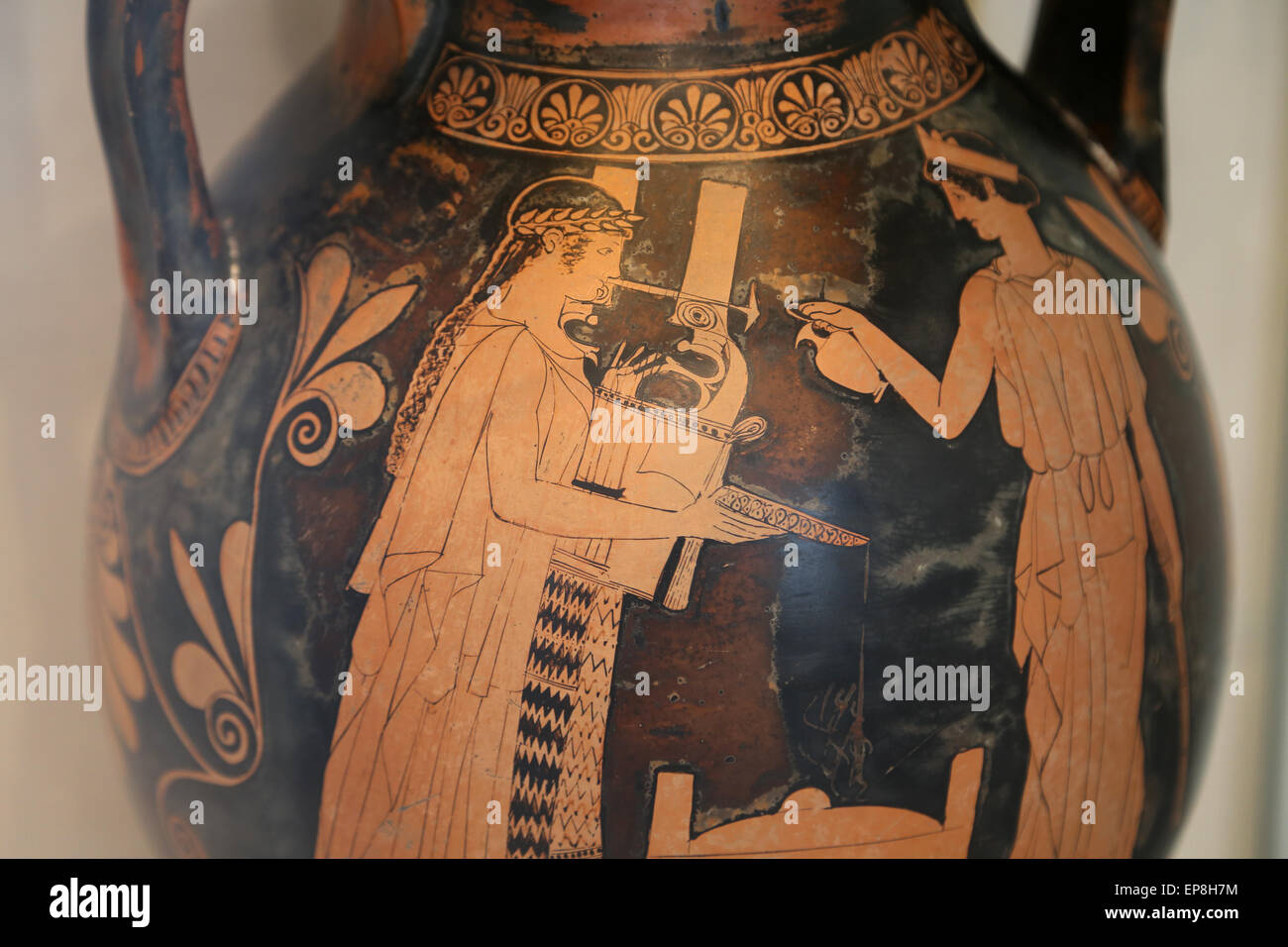 Terracotta pelike (jar). Greek, Attic, red-figure, mid 5th century BC. Apollo and his sister, Artemis, pouring libation - Stock Image