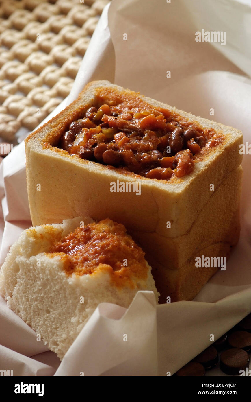 Bunny chow is a meal found exclsively in South Africa and it has its origins in Durban Kwa zulu Natal it is curry - Stock Image