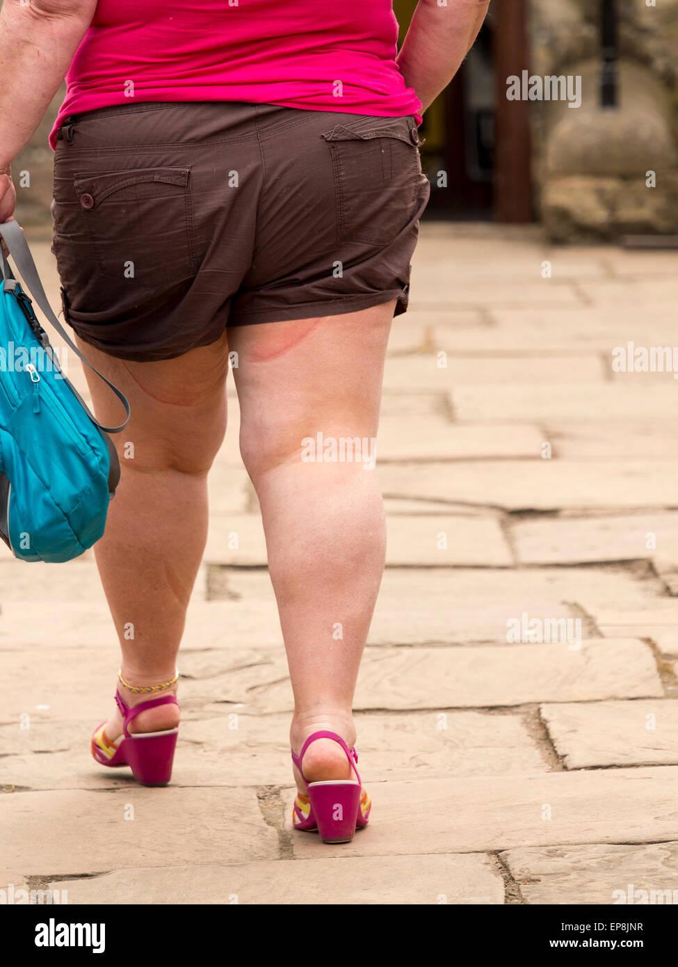 woman wearing shorts fat stock photos & woman wearing shorts fat
