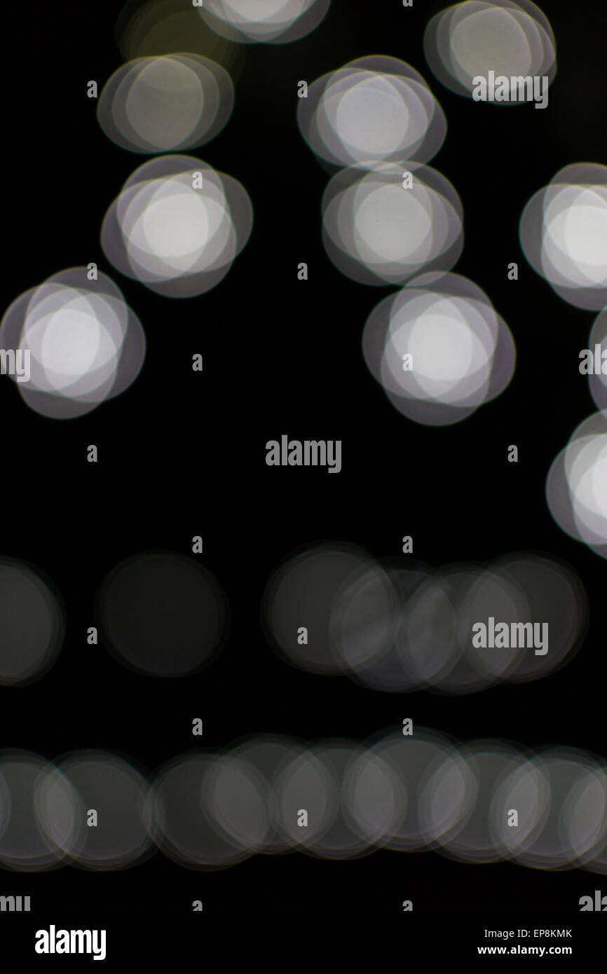 Fading White Bokeh Blurred Light Effect Using A Black Background Stock Photo Alamy