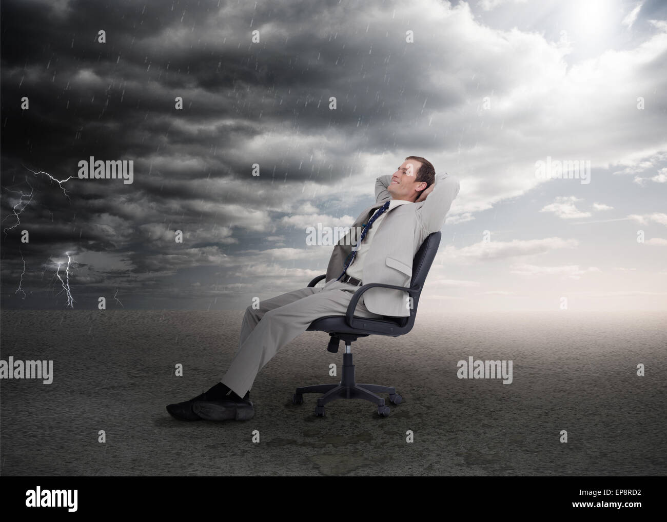 Attractive businessman sitting on a swivel chair - Stock Image