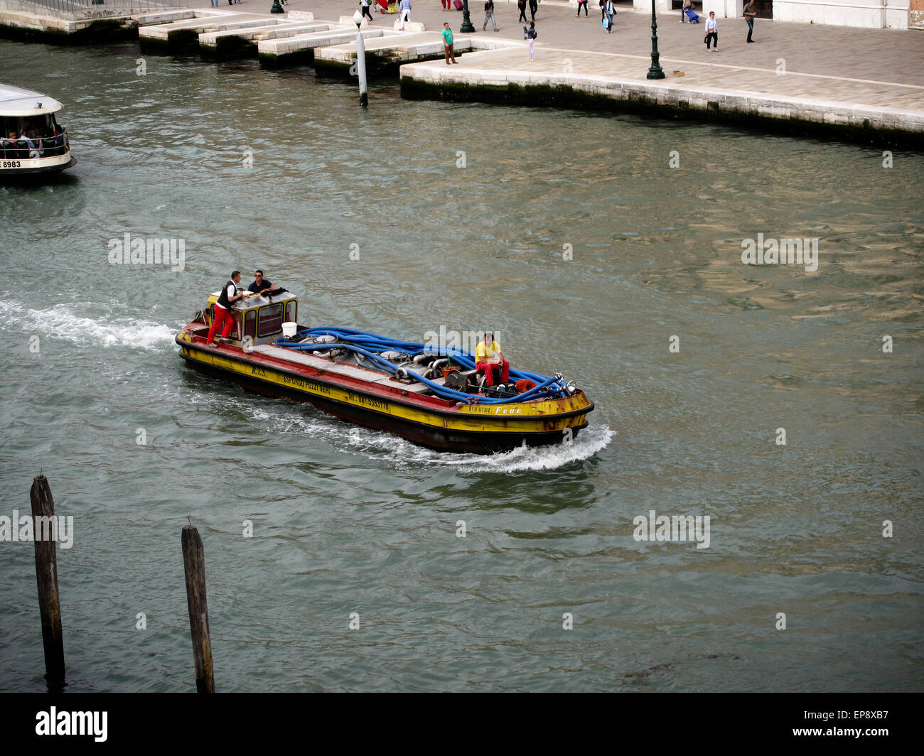 A fuel tanker on the Grand Canal in Venice - Stock Image