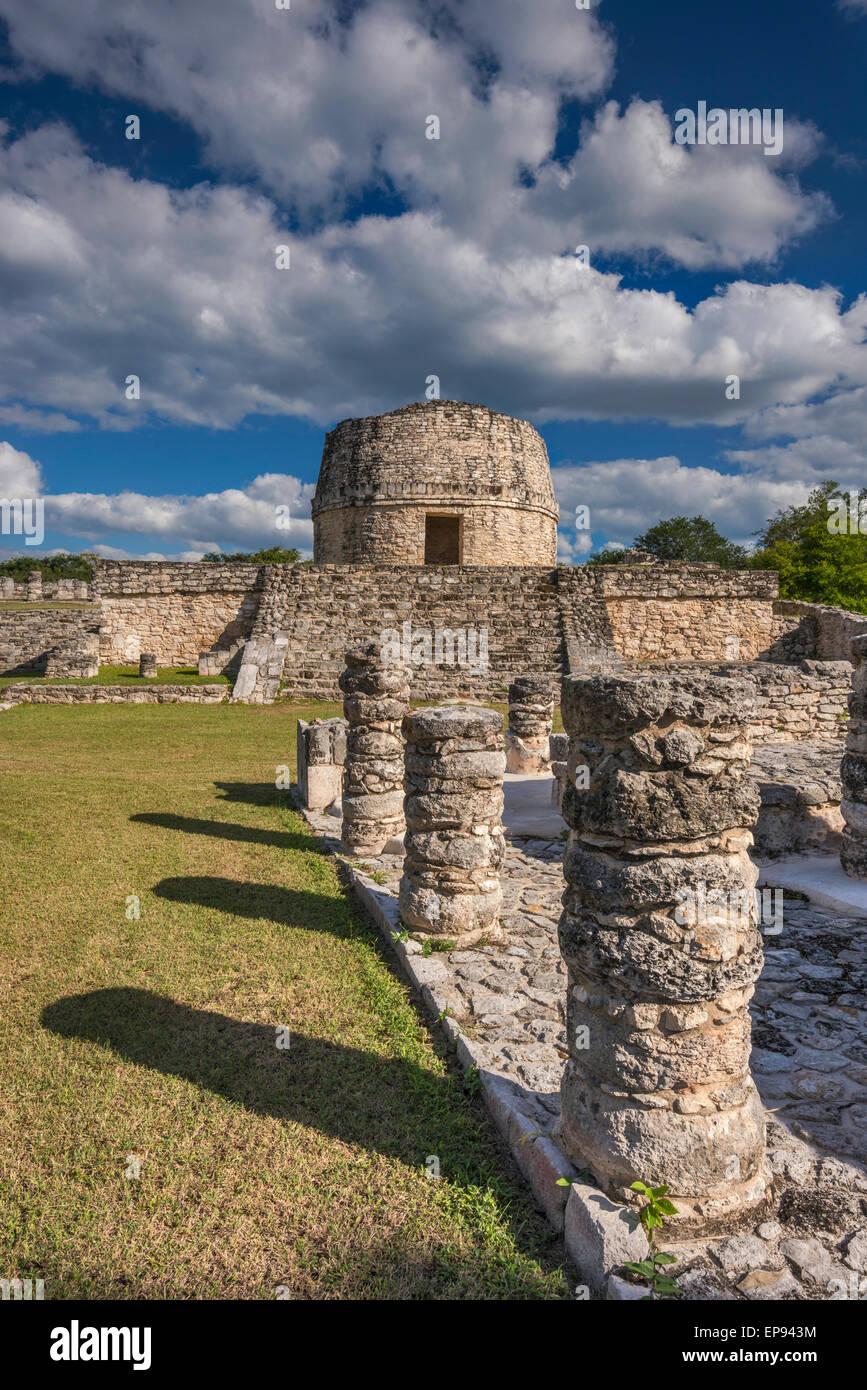 Columns at plaza, El Templo Redondo (Rounded Temple), Maya ruins at Mayapan archaelogical site, Yucatan state, Mexico - Stock Image