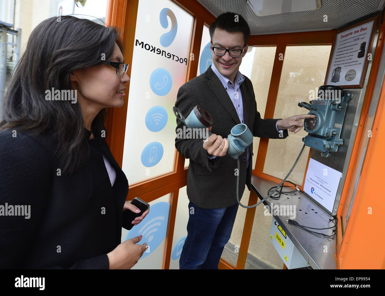 Vladivostok, Russia. 15th May, 2015. Local residents use a multifunctional telephone booth that has been unveiled - Stock Image