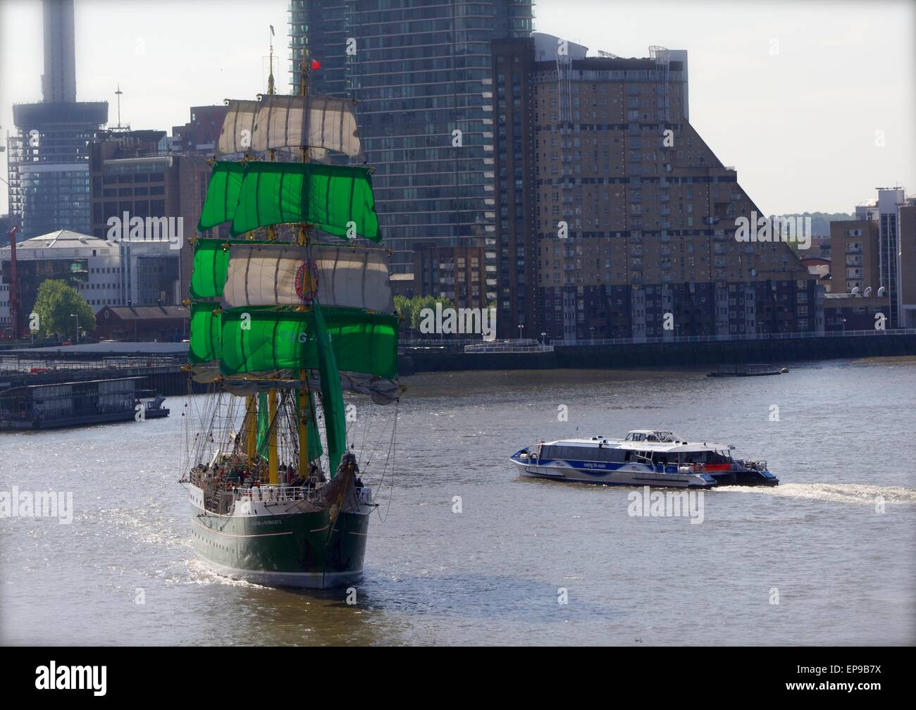 London, UK. 15th May, 2015. German sail training ship Alexander von Humboldt II passing Thames Clipper at Canary Stock Photo