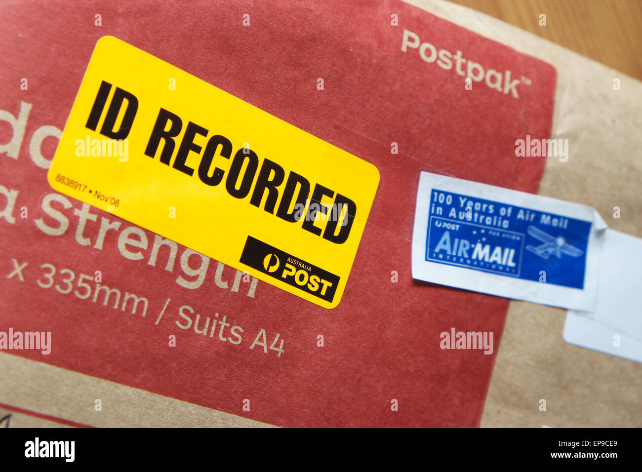 Australia Post postpak jiffy bag with ID Recorded delivery and Air Mail labels - Stock Image