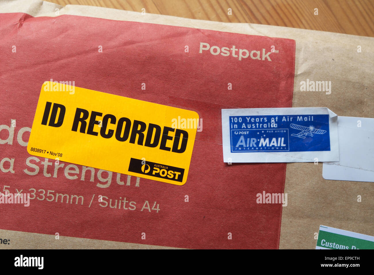 Australia Post postpak jiffy bag with ID Recorded delivery and Air Mail lables - Stock Image