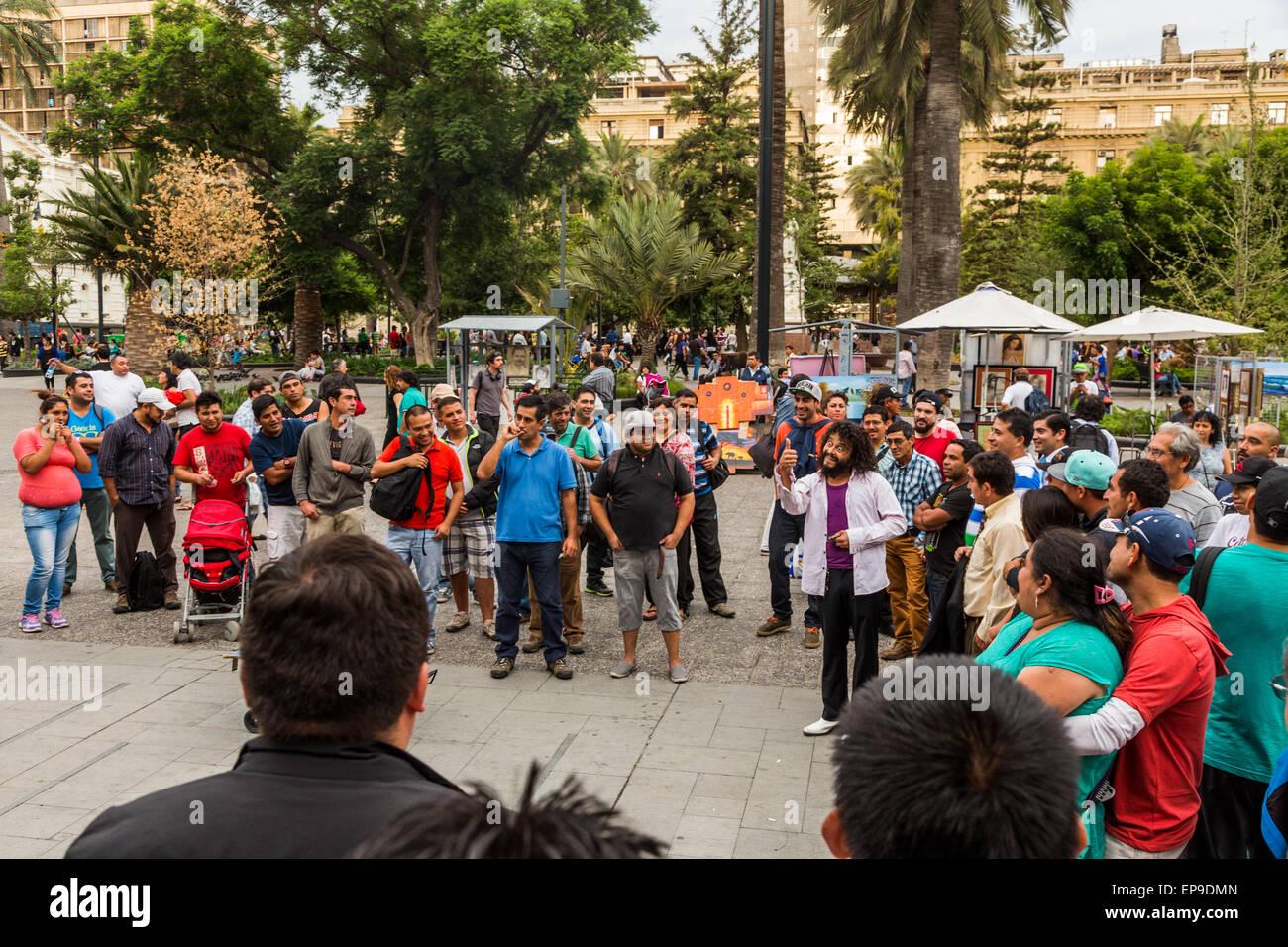 comedian performing, Plaza de Armas, Santiago, Chile - Stock Image