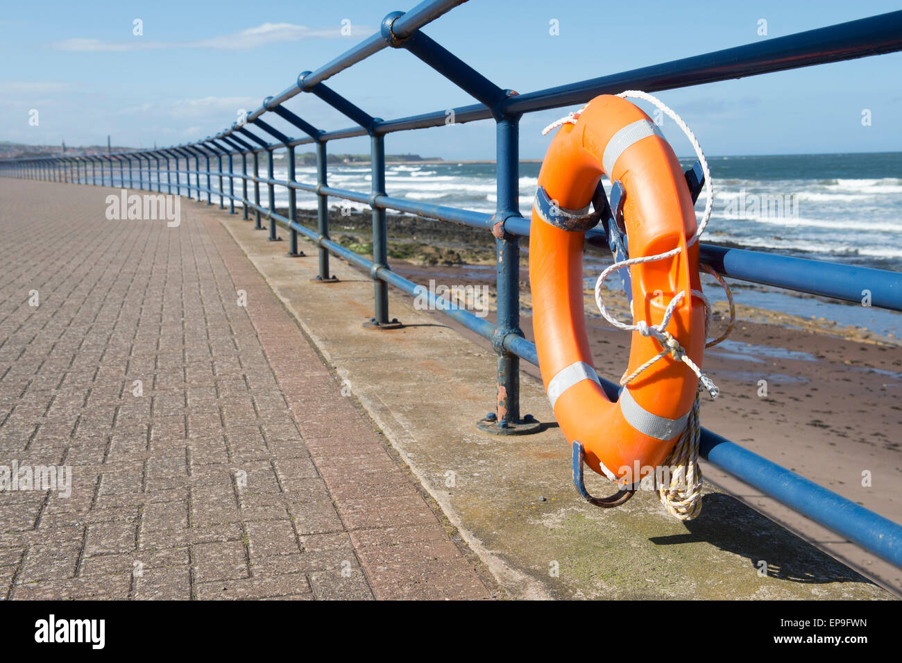 Lifebelt on the promenade railing at Spittal Beach, Berwick upon Tweed, Northumberland, England - Stock Image