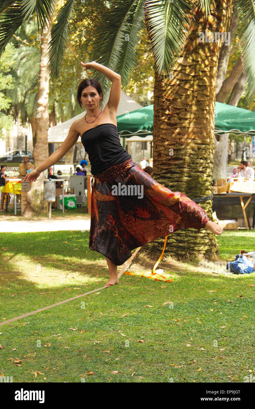 Woman balancing on a tightrope - Stock Image