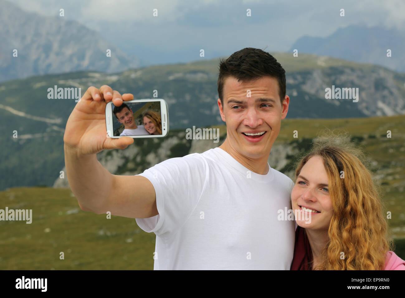 Foto mit dem Smartphone als Erinnerung an den Urlaub - Stock Image