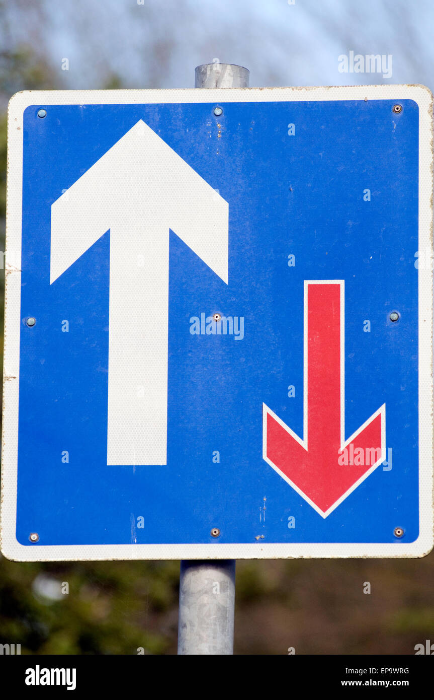 priority road sign signs give way right of way natural selection evolution Darwin Darwinism evolutionary - Stock Image