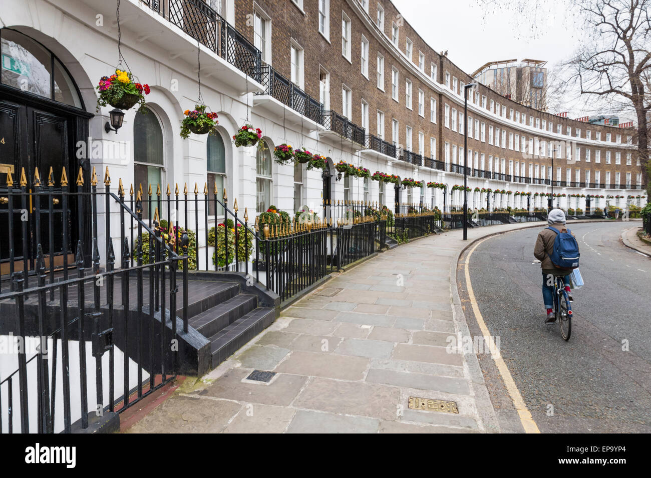 Georgian townhouses. A crescent of terraced houses at Cartwright Gardens, Bloomsbury, London, England, UK - Stock Image