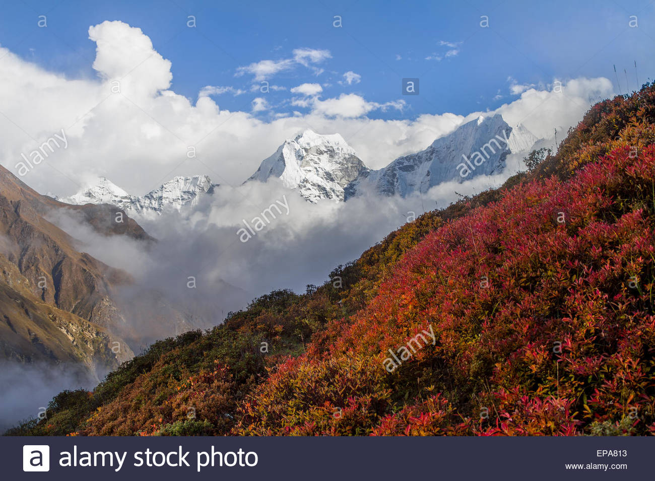 Sharp, jagged Himalayan peaks cut through a clearing storm as seen from Dole in Sagarmatha National Park, Nepal - Stock Image