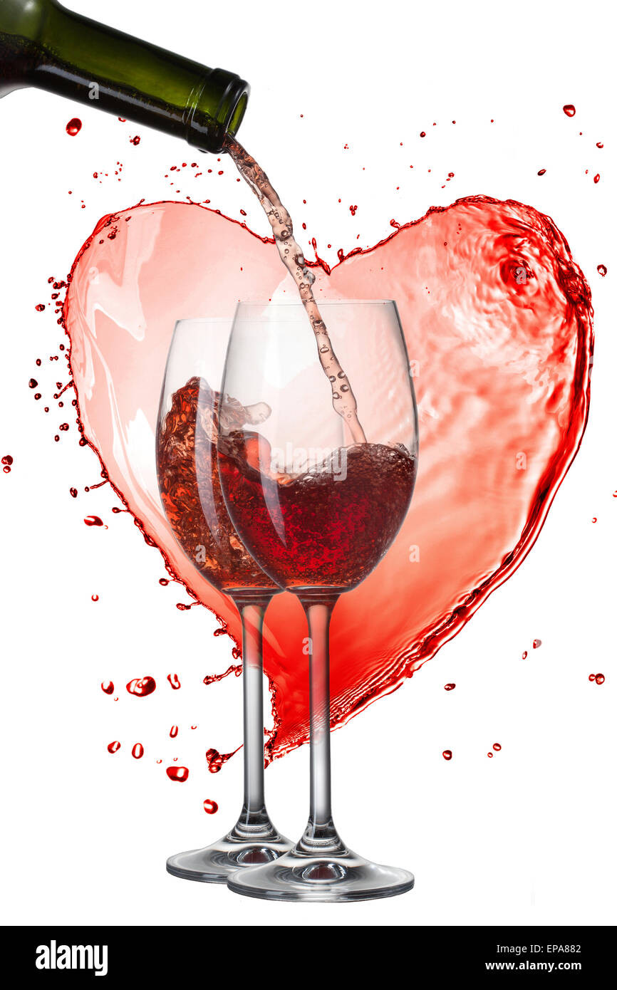 c391279fc113 Red wine pouring into glasses with splash against heart isolated on white