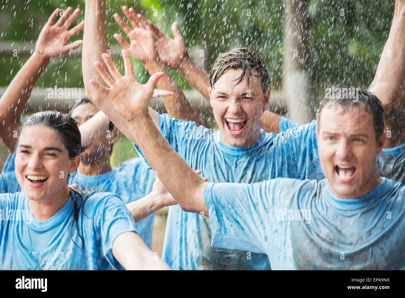 enthusiasm team cheering rain boot camp - Stock Image