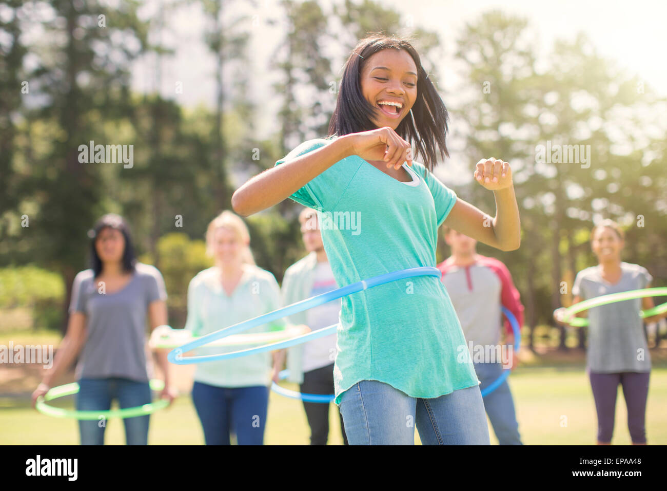 enthusiasm woman spinning plastic hoop - Stock Image
