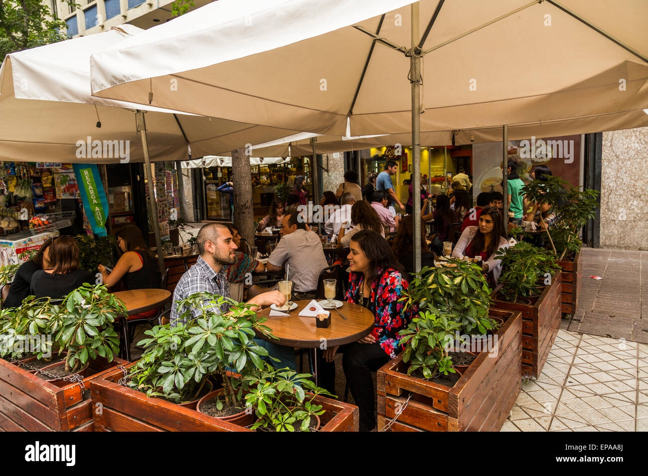 patrons at sidewalk cafe, downtown Santiago, Chile - Stock Image