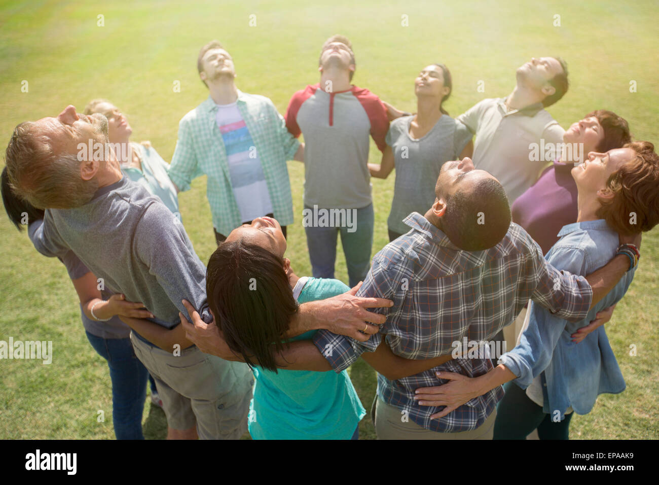 team connected circle basking sunny field - Stock Image