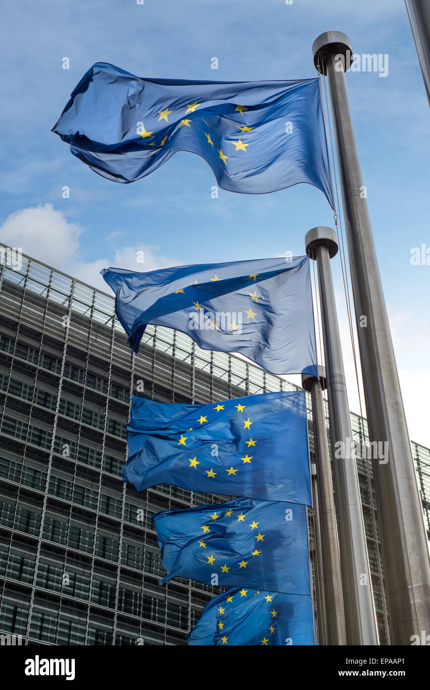 European Union flags in front of the Berlaymont building (European commission) in Brussels, Belgium. - Stock Image