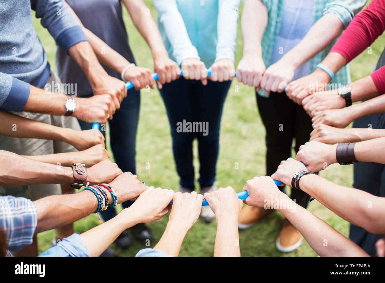 team connected circle plastic hoop - Stock Image