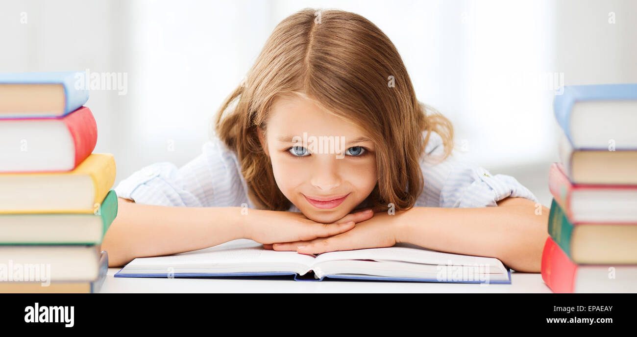 pretty girl with many books at school - Stock Image