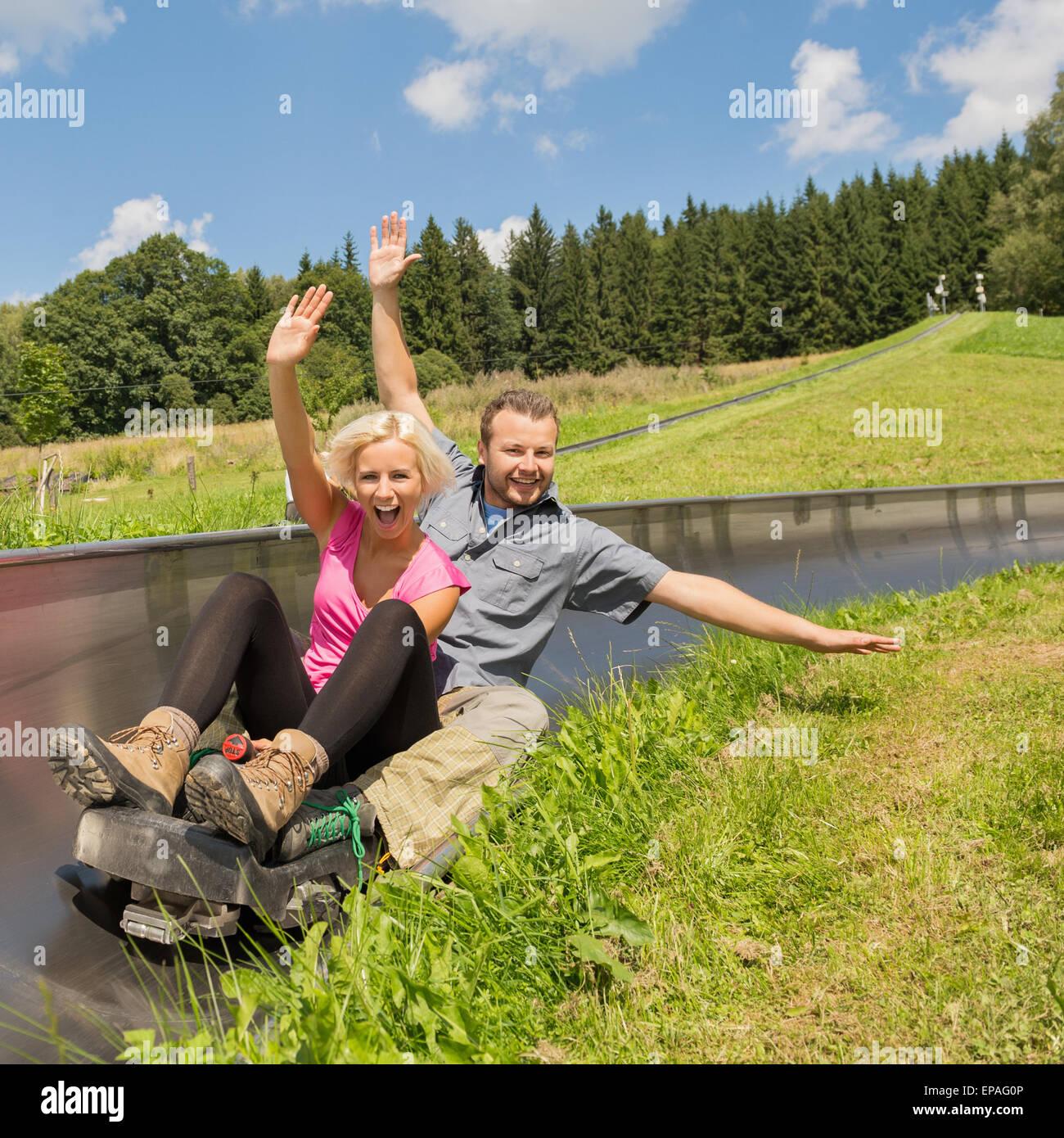 Couple Enjoying Their Summer Holidays Stock Photo: Couple Enjoying Summer Sledge Stock Photo: 82595990