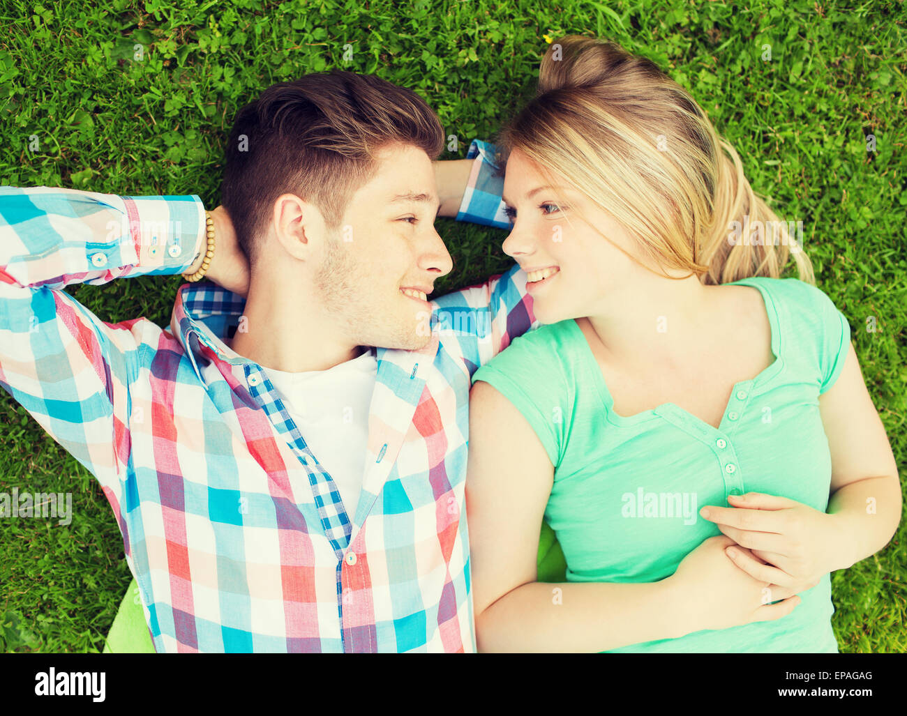 smiling couple in park - Stock Image
