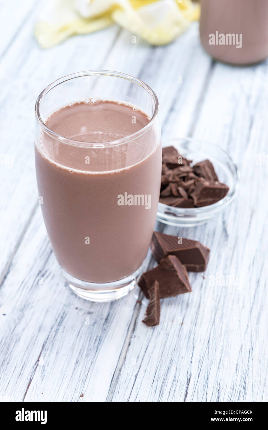 Chocolate Milk (close-up shot on bright wooden background) - Stock Image
