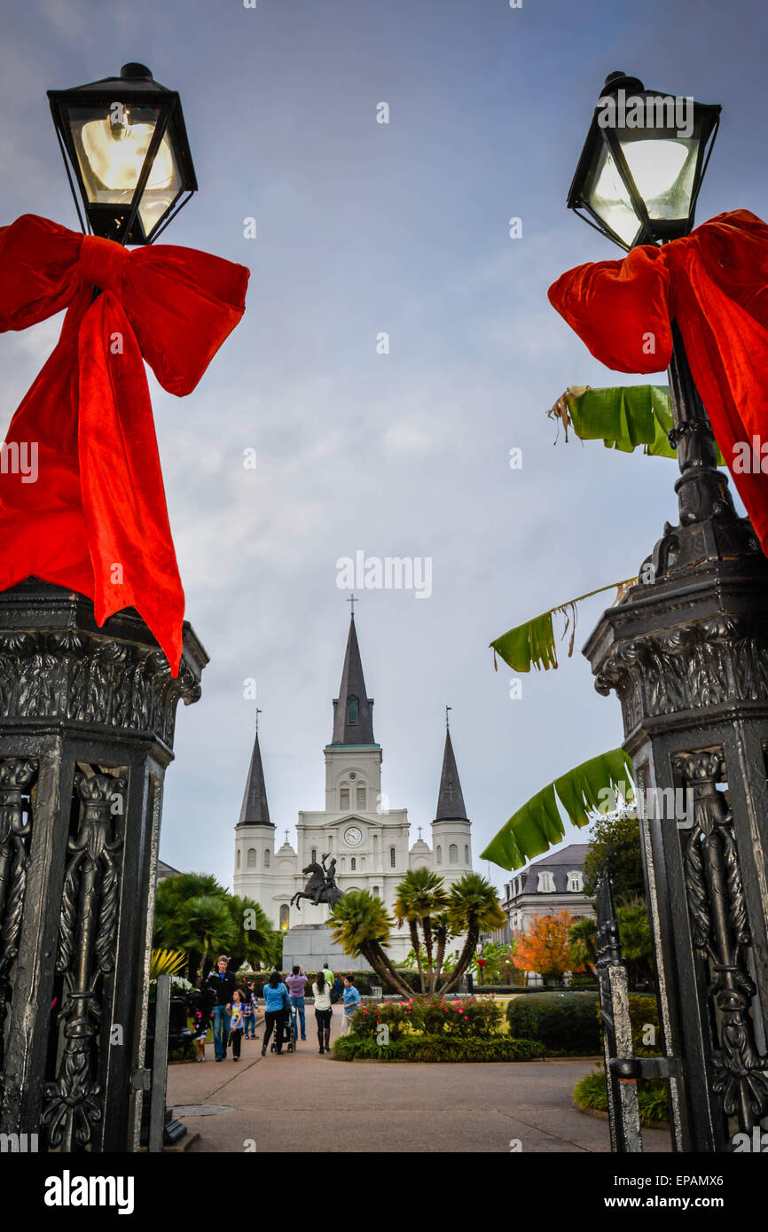Giant red bows are tied around the lamp posts at the entrance to Jackson Square in the French Quarter in New Orleans, - Stock Image
