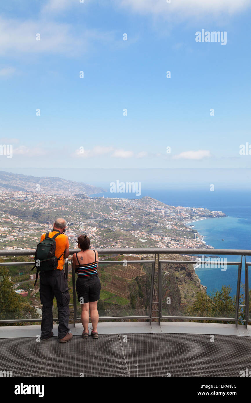 A tourist couple on the viewpoint at the top of Cabo Girao, the highest sea cliff in Europe, Madeira, Europe - Stock Image