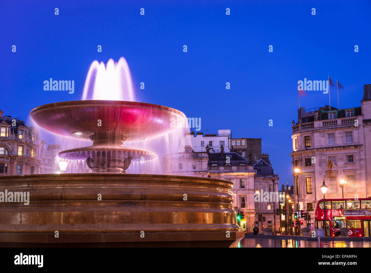 A fountain in Trafalgar square, London, taken in Spring. - Stock Image