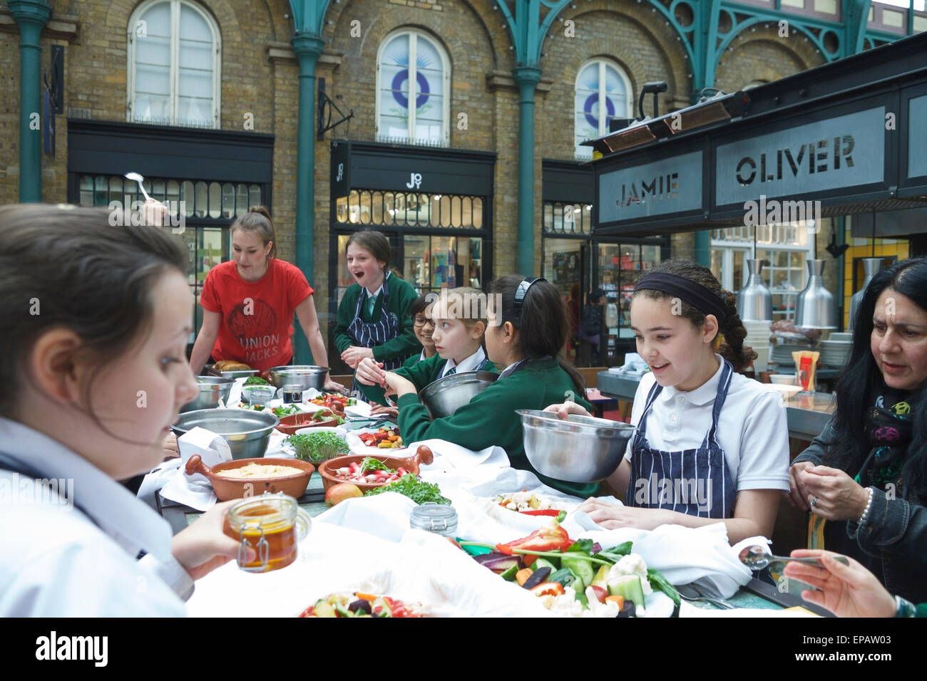 London, UK. 15th May, 2015. Jamie Oliver's Union Jacks eatery, at Covent Garden, invited 30 pupils from St Josephs - Stock Image