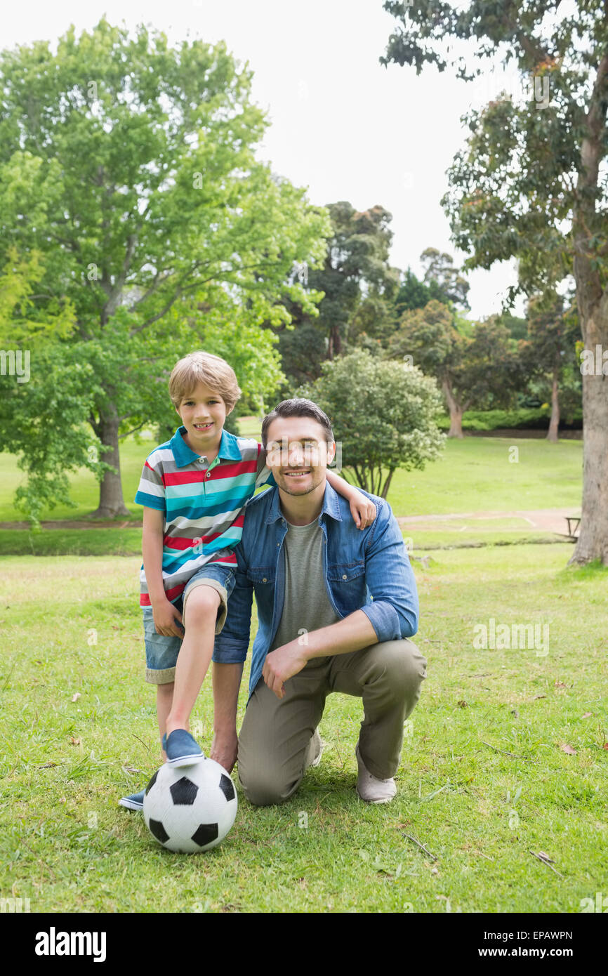 Father and son with ball at the park - Stock Image