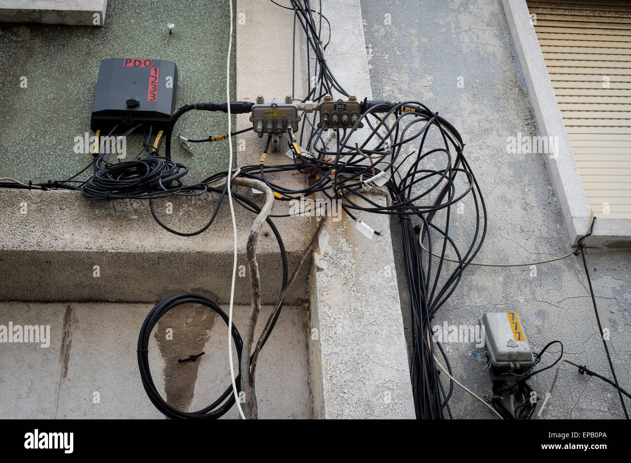 wires and cables for electricity and telephones on the wall ... on telephone equipment, cable wiring, telephone handset holder, telephone plugs, telephone transmitter, telephone components, telephone computer, telephone tools, telephone switch, telephone number, telephone systems, data wiring, telephone design, telephone diagram, telephone blue, telephone cables, computer network wiring, telephone connectors, telephone relay, telephone wires, telephone schematic, computer wiring, telephone service, low voltage wiring, electrical wiring, telephone jacks, telephone panel board, telephone repair, telephone communication system, telephone data lines, telephone line work, telephone installation, telephone operators,