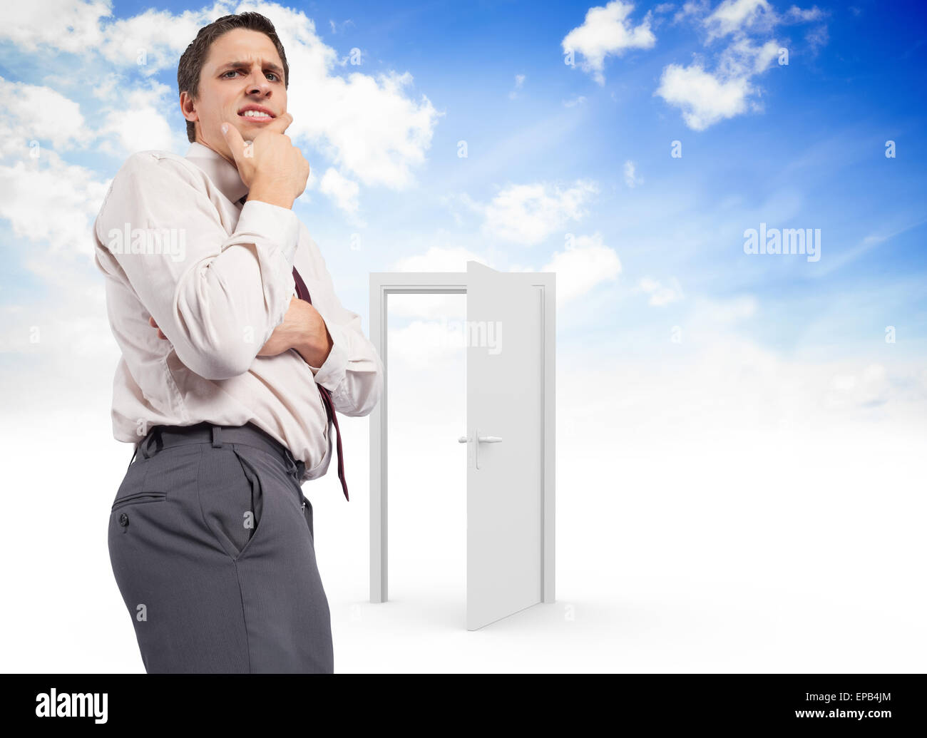 Composite image of thoughtful businessman with hand on chin - Stock Image