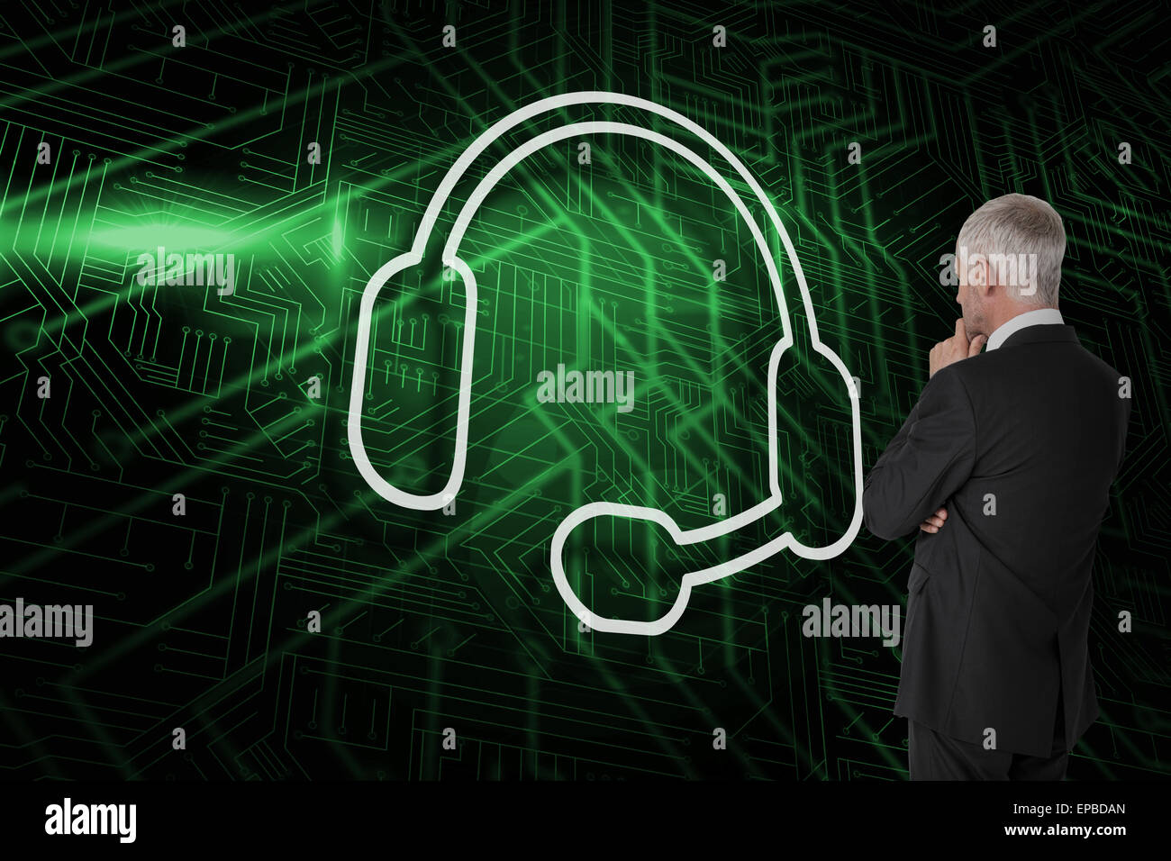 Composite image of headset with businessman looking Stock Photo