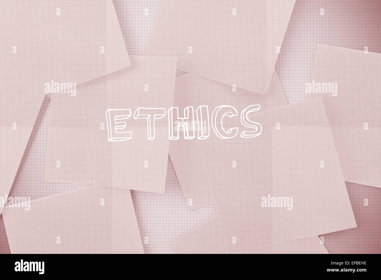 Ethics against white paper strewn over grid - Stock Image