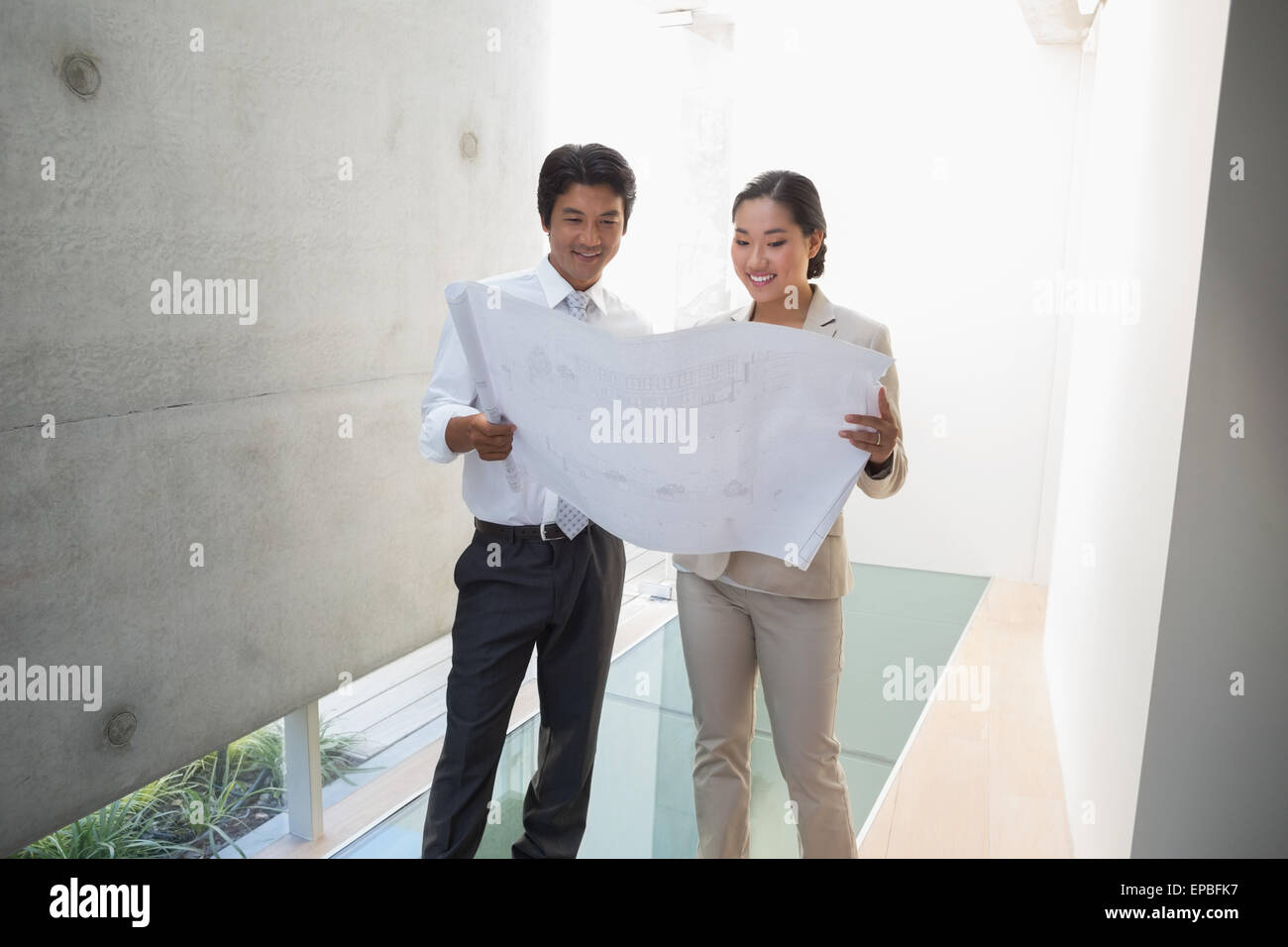 Estate agent looking at blueprint with potential buyer stock photo estate agent looking at blueprint with potential buyer malvernweather Images
