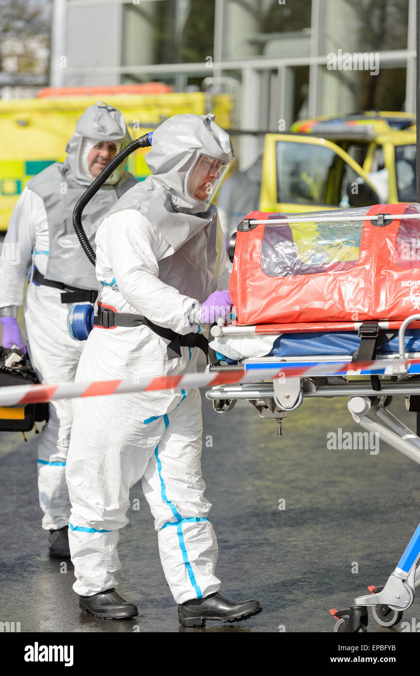 Biohazard medical team with stretcher - Stock Image