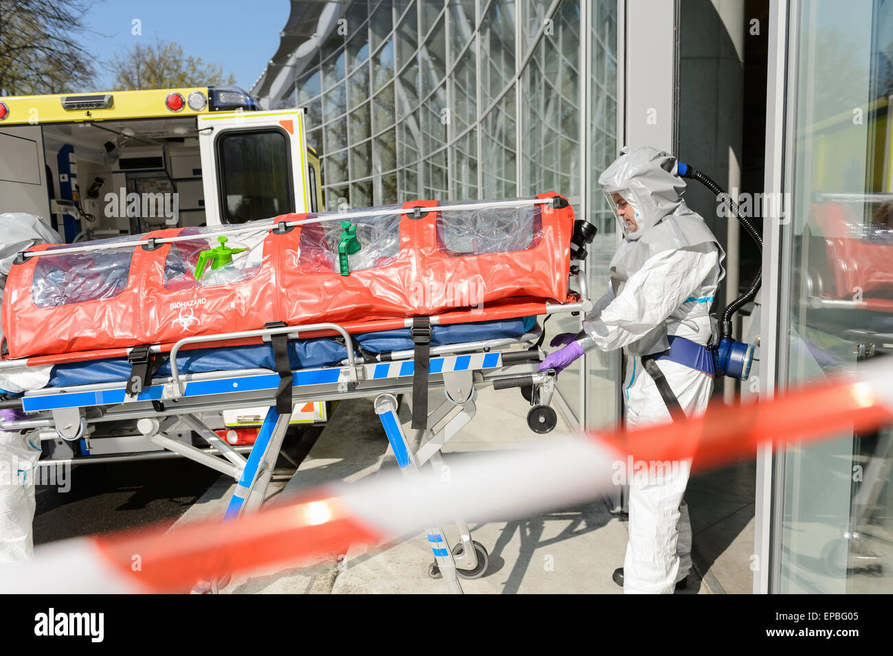 Biohazard medical team member with stretcher - Stock Image