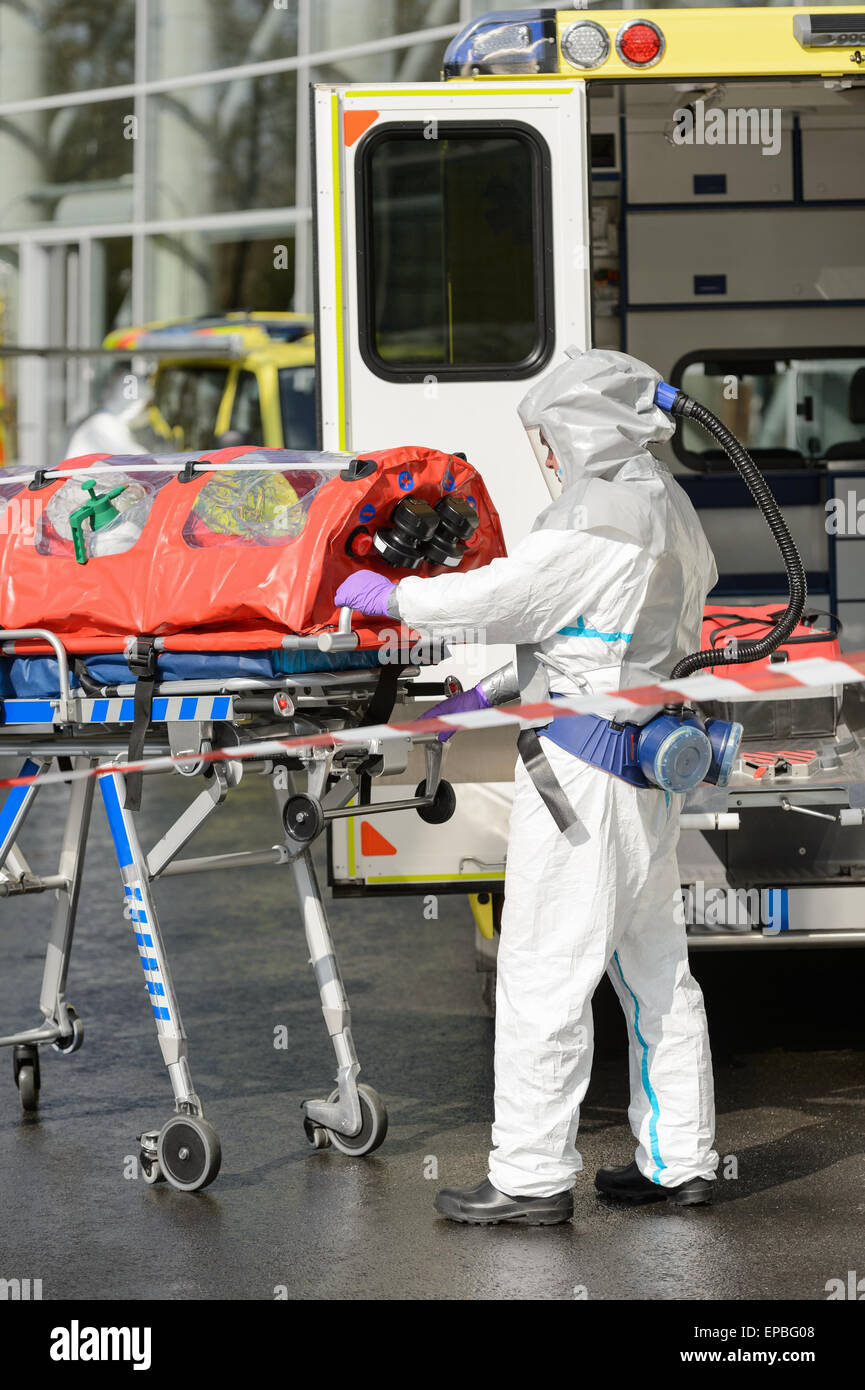 HAZMAT medical team member with stretcher - Stock Image
