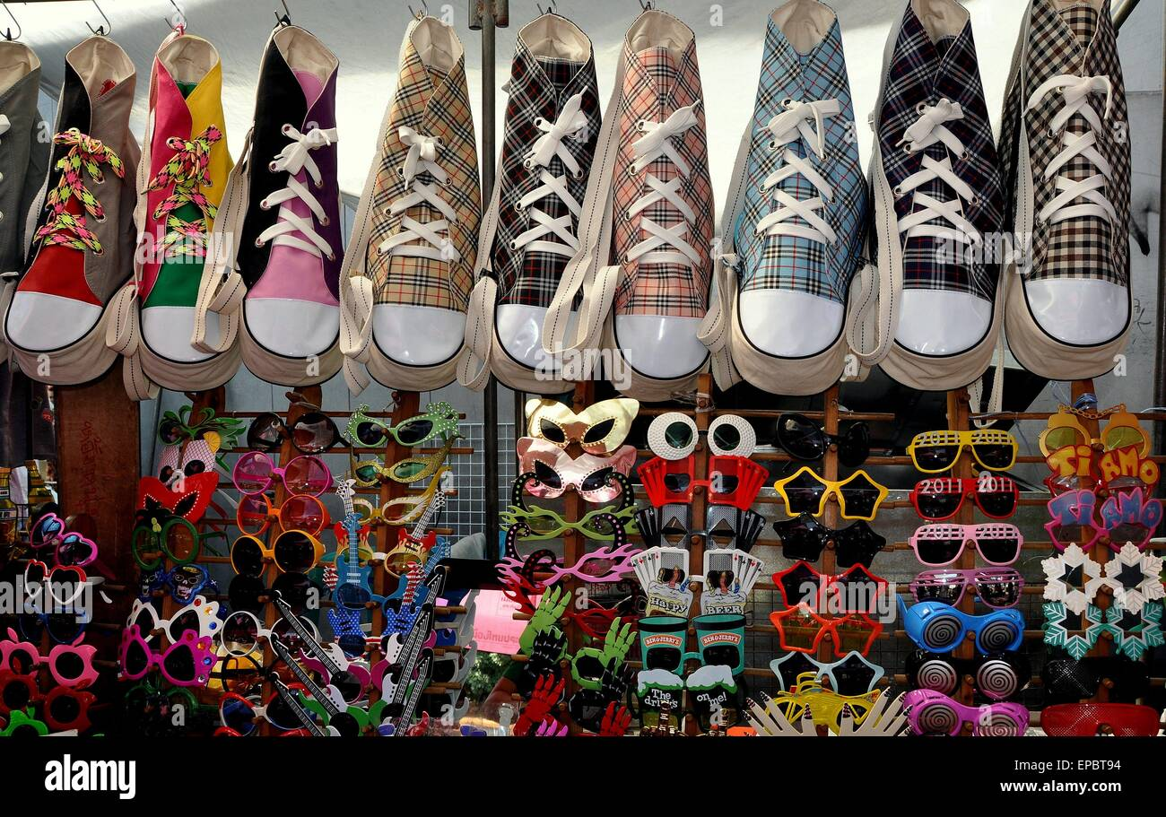 Bangkok, Thailand:  Amusing sunglasses and zippered sneaker shaped shoulder bags at a street vendor's stand - Stock Image